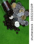 thai baht and coffee beans | Shutterstock . vector #1032210109