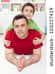 Father and son together at home - stock photo