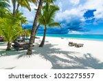 trou aux biches  public beach... | Shutterstock . vector #1032275557