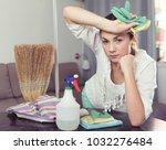 forworn sad girl cleaning... | Shutterstock . vector #1032276484