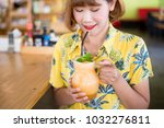 woman hold melon smoothie in a...   Shutterstock . vector #1032276811