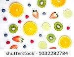sliced fruits on white... | Shutterstock . vector #1032282784