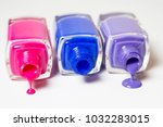 three nail polishes lie on a... | Shutterstock . vector #1032283015