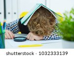 tired schoolboy is sitting at a ... | Shutterstock . vector #1032333139