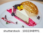 sliced cheese cake and edible... | Shutterstock . vector #1032348991