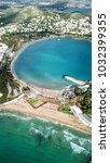 Small photo of Aerial drone bird's eye photo of famous celebrity sandy beach of Astir or Asteras in south Athens riviera with turquoise clear waters, Vouliagmeni, Greece