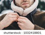 detail shot of a man buttoning... | Shutterstock . vector #1032418801