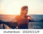 young girl in the sunset light... | Shutterstock . vector #1032421129