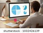 focused businessman working on... | Shutterstock . vector #1032426139