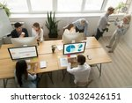 diverse young and senior office ... | Shutterstock . vector #1032426151