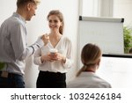 young colleagues talking... | Shutterstock . vector #1032426184