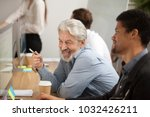 smiling senior employee... | Shutterstock . vector #1032426211