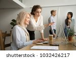 young businesswoman teaching... | Shutterstock . vector #1032426217