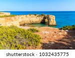 green plants on cliff and view... | Shutterstock . vector #1032435775