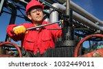 industrial worker at work in... | Shutterstock . vector #1032449011