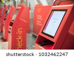 red self machines check in... | Shutterstock . vector #1032462247