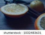 cinnamon sticks and orange... | Shutterstock . vector #1032483631