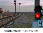 railroad track and stop light - stock photo