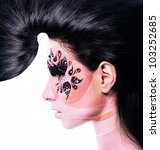 flower woman with creative hair and face art with rhinestone on white background - stock photo