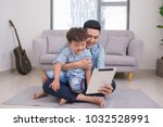 father and son are using a... | Shutterstock . vector #1032528991