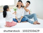 asian little girl giving... | Shutterstock . vector #1032533629