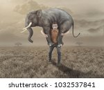 man carries an elephant in the... | Shutterstock . vector #1032537841