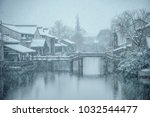 snow covered a small town | Shutterstock . vector #1032544477