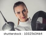 attractive female fencer in... | Shutterstock . vector #1032563464