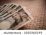 japanese yen banknotes close up ... | Shutterstock . vector #1032565195