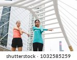 sportswomen stretching after... | Shutterstock . vector #1032585259