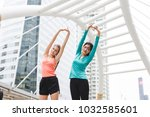 sportswomen stretching after... | Shutterstock . vector #1032585601