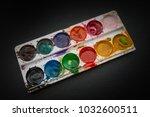 watercolor in a box on dark...   Shutterstock . vector #1032600511