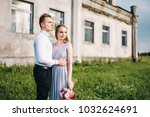 bride and groom in a park... | Shutterstock . vector #1032624691