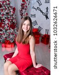 young beautiful girl in a red... | Shutterstock . vector #1032626671