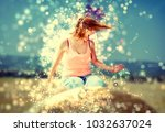 young crazy woman sits on the... | Shutterstock . vector #1032637024