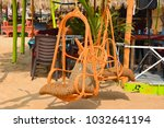 hanging wicker chair in a caf ... | Shutterstock . vector #1032641194