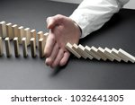 hand stopping domino concept  ... | Shutterstock . vector #1032641305