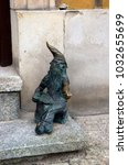 Small photo of Wroclaw, Lower Silesia, Poland - 18 July 2012: Bronze dwarf