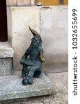 Small photo of Wroclaw, Lower Silesia, Poland - 18 July 2012: Bronze dwarf