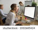 tired businesswoman yawning... | Shutterstock . vector #1032685414