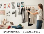 female fashion designer works... | Shutterstock . vector #1032685417