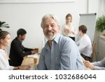 smiling male senior team leader ... | Shutterstock . vector #1032686044
