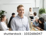smiling young businessman... | Shutterstock . vector #1032686047