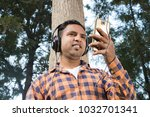 Small photo of college boy enjoining music in park