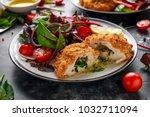 breaded chicken kiev breast... | Shutterstock . vector #1032711094