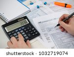man filling us tax form. tax...   Shutterstock . vector #1032719074