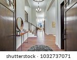 chic entrance foyer with high... | Shutterstock . vector #1032737071