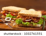 toasted sandwich with bacon ... | Shutterstock . vector #1032761551