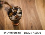 top view pour cola in gto glass ...   Shutterstock . vector #1032771001