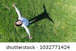 boy portrait aerial top view | Shutterstock . vector #1032771424